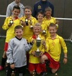 AF Blakemore Junior Football Competition winners, Harden Primary School, celebrate with Blakemore Cup