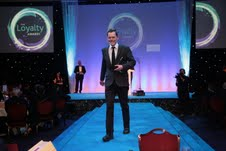 Chris Ward, founder and CEO of Blue Dot, enjoys The Loyalty Awards catwalk after winning the award for Best CSR Initiative linked to Loyalty
