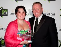 Customer Champion Award winner Caroline Dodd, from the Looe store in Cornwall, collects her award from food stores & logistics director, David Mockford