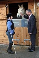 Paul Lewney, managing director, Kavli joins disabled rider Liz Gandy (a lecturer at Sunderland University) for a tour of the new 'Kavli' Stables at Washington Riding Centre following a £25,000 donation from The Kavli Trust.