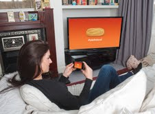 Smart phone users take a picture of the biscuit from the TV advertisement