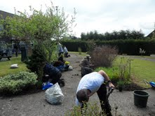 AF Blakemore staff take part in a Give and Gain Day at a sheltered housing garden
