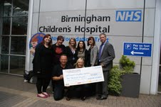 Employees from Blakemore Foodservice presenting Birmingham Children's Hospital with a cheque for £6,000